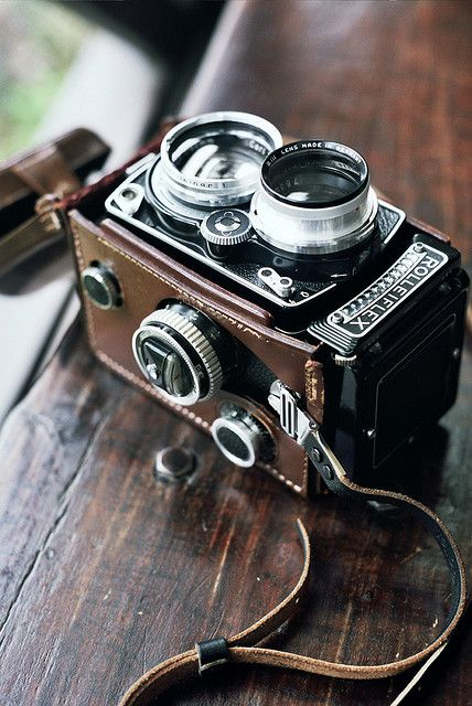Rolleiflex Vintage Film Camera with a Leather strap. It looks so intricate for such an old camera!