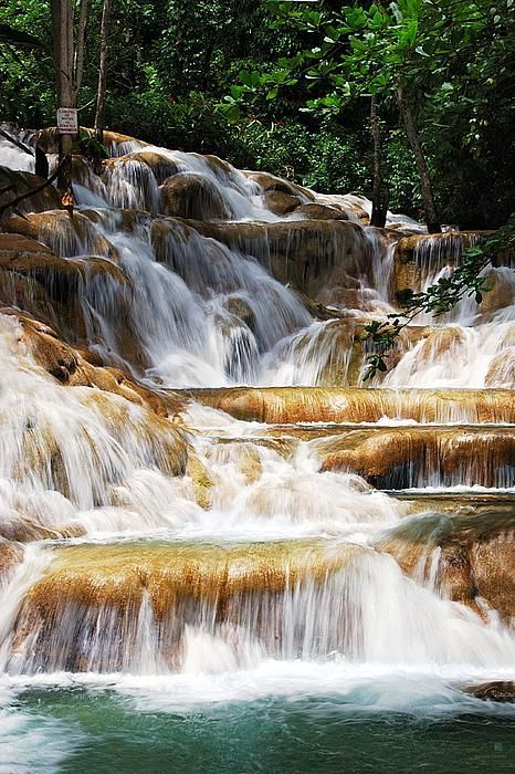 Dunn's River Falls, Ocho Rios, Jamaica. Have visited 3 times loved it every time and hope to go another 3 times in my lifetime. So pretty.