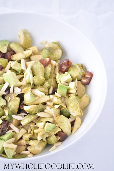 Brussels Sprouts Salad with Almonds and Dates in a Maple Dijon Dressing.  The best healthy salad recipe ever!  Vegan and gluten free.