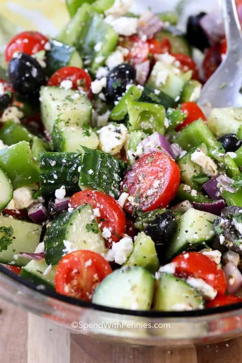 Greek salad is an easy summer side dish perfect for potlucks and parties! Tomatoes, cucumbers and bell peppers in a simple dressing is both fresh and delicious! #spendwithpennies #Greeksalad #saladrecipe #easysidedish #sidedishrecipe #Greeksaladrecipe #freshproduce
