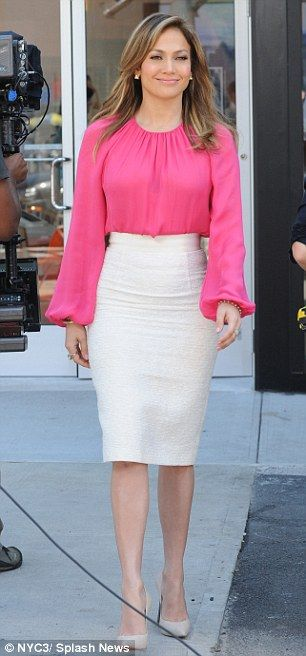 Can you hear me now? The two-time Grammy nominee flaunted her famous curves in a hot pink peasant blouse, white pencil skirt, and nude heels