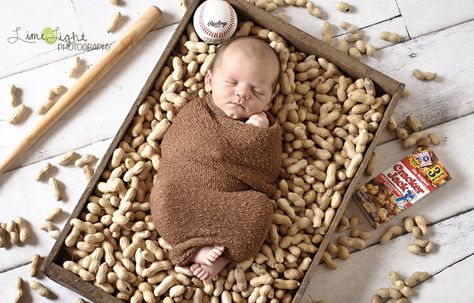 Newborn baby baseball theme photo shoot.  Watch out for possible peanut allergies!
