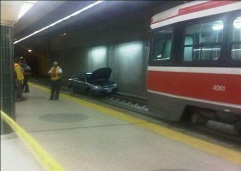 Poor Planning On Someones Part In This Picture: Photo of car in subway
