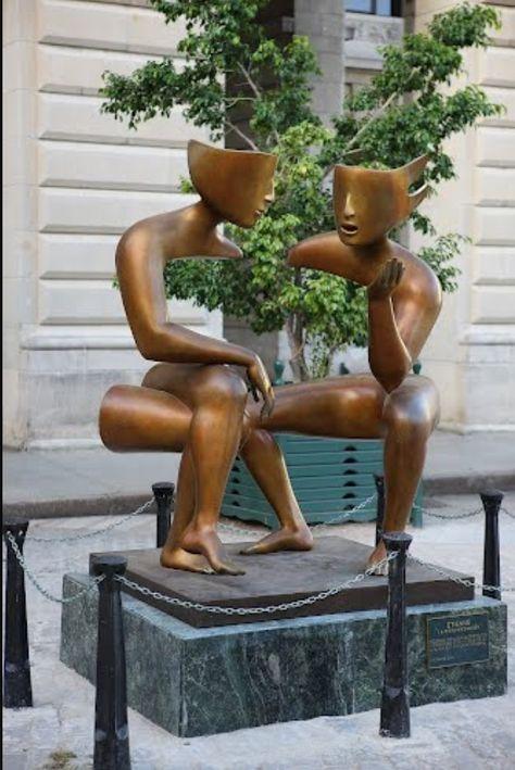 Street art by way of Sculpture la conversacion in Plaza de San Francisco in Havana, Cuba