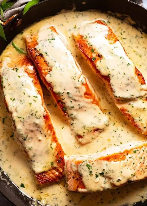 Creamy Herb & Garlic Salmon Sauce in a skillet, fresh off the stove, ready to be served