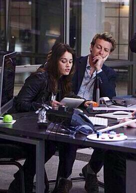 Patrick Jane (Simon Baker) and Teresa Lisbon (Robin Tunney)~ The Mentalist .I just love how he is touching her hair