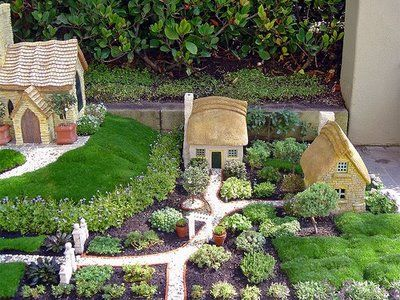 thatched roof fairy garden..perfect!