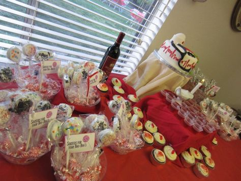 """My RN Grad Party Dessert table. Chocolate Covered Oreos labeled """"suckers for your booboo's"""" , Chocolate cupcakes with mike's as medicine pills, medicine cup jello shots, chocolate covered pretzels as """"diploma sticks"""" and my red velvet nursing cake."""