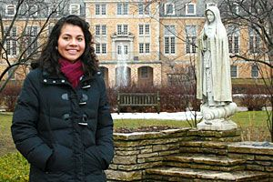 Silvia visits one of the college's most beloved spots:   a statue of Saint Mary on an island in Lake Marian.