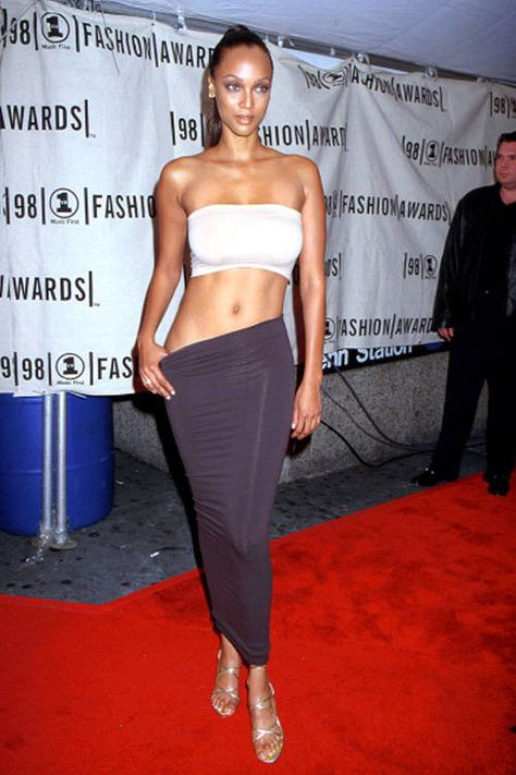 Like her cropped tube top and tube skirt, Tyra Banks' metallic, shiny shoes were also a fashion.