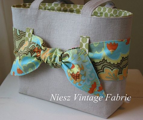 what about getting some fabric and using iron on hem tape to make a contrasting interior