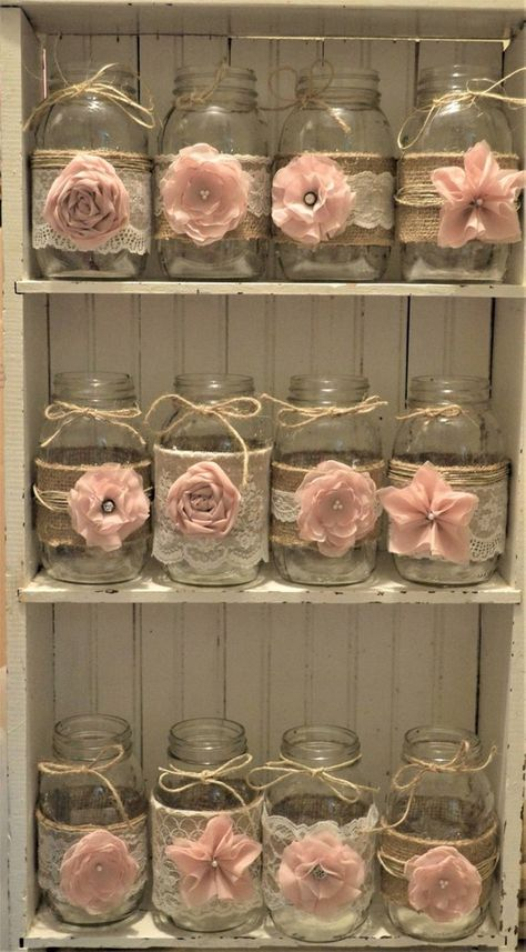 12 handmade mason jar sleeves. Perfect for a rustic wedding or a baby shower. Burlap adorned with lace and handmade light pink flowers. Please note that mason jars are not included. These are made to fit your Ball quart sleeves. This is to save you on shipping charges. Fits Ball QUART SIZE REGULAR