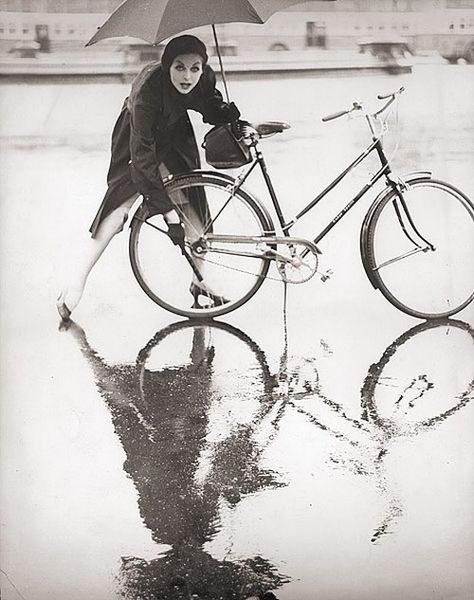 Model Anne St Marie photographed in the rain by her husband, Tom Palumbo, 1950s.