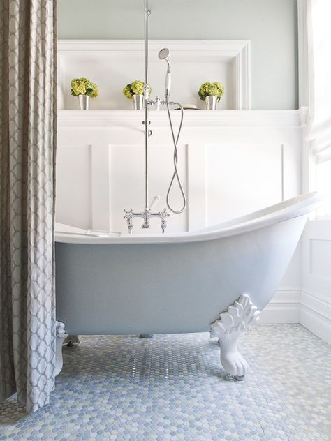 This is one elegant bathroom--from the soothing hues of the penny floor tiles to the wainscoting and thoughtful, simple accents. | via Design Meet Style
