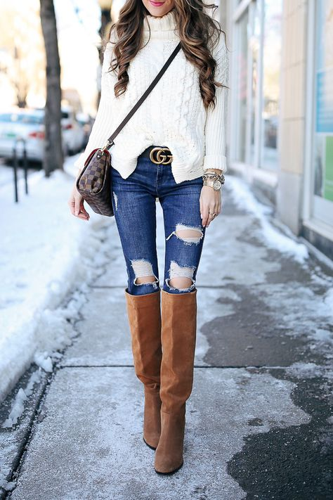 White cable knit sweater with distressed denim jeans and tan suede OTK boots. Bet you wish it was warmer!