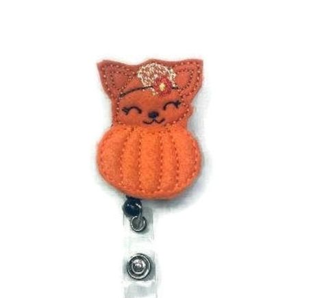 ~This is a listing for a Fall Fox Badge Reel, Fox Pumpkin Reel, Name Tag Holder, Work Badge Holder, Nurse Badge Reel, Teacher Badge Reel, Retractable Reel, ID Badge ~These are perfect badge holders and we are starting to offer a variety to choose from. ~We attach feltie to a retractable alligator swivel clip badge reel or slide clip. Refer to the drop down for options. ~As of right now all reels we carry come in black. ~Check out the rest of our badge reels. We are adding more daily.