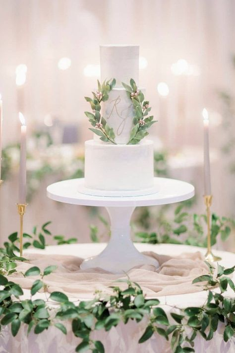 If you're looking for a great way to honor your newly-shared last name or a combination of your initials, the SWEETEST way to do so is on your wedding cake! 🍰 We're in love with this simple branded confection captured by LBB photographer @hunterryanphoto, surrounded by an abundance of greenery. 🍃   LBB Photography: @hunterryanphoto #stylemepretty #weddingcake #weddingmonogram