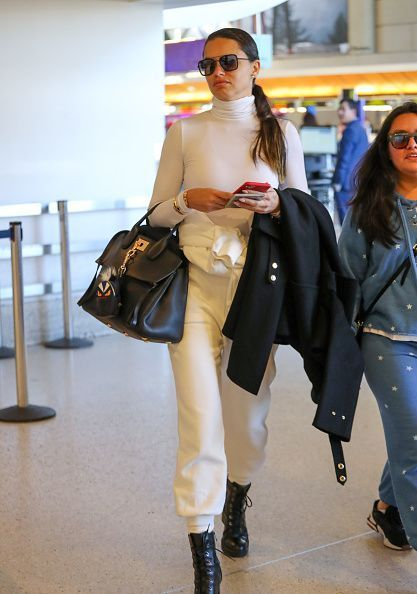 Adriana Lima Black Leather Boots Airport Style Autumn Winter 2020 On Sassy Daily In 2020 Adriana Lima Style Airport Style Fashion