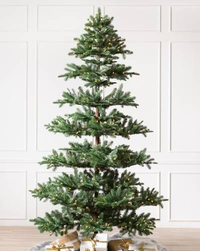 An Organic Silhouette Gives The Tree A Natural Highly Realistic Look Realistic Artificial Christmas Trees Faux Christmas Trees Noble Fir Christmas Tree