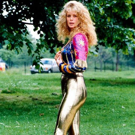 Model Rachel Hunter, who married Rod Stewart in went with gold lamé pants in an