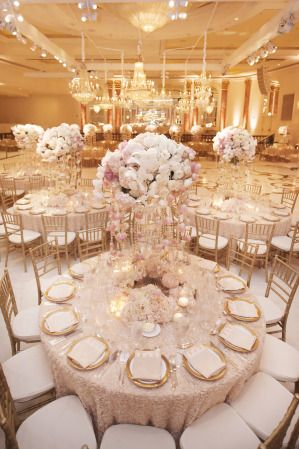 We turned the ballroom at the Beverly Wilshire hotel into a blush and gold dream. The floral centerpieces finished with hanging roses and glimmering ...