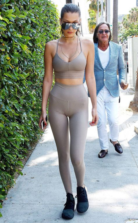 Going Nude from Bella Hadid's Best Looks Not many people can pull off nude leggings and matching crop top, but Bella makes it look easy.