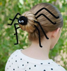 What a cute Halloween hair idea! Who says spiders have to be creepy crawlies...they can be cute, too! This adorable Spider Spun Bun would be great to wear to school!