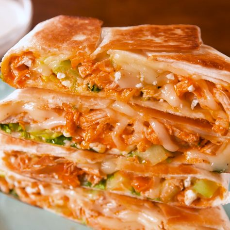 We love crunchwrap supremes and we love buffalo chicken wings so naturally we combined them! This is our favorite take on buffalo chicken and have a strong feeling you are going to love it too.   Get the recipe at Delish.com. #delish #easy #recipe #crunchwrap #buffalochicken #tacobell #chickendinners #fastfood #copycat