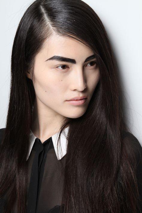 be bold - the sleek hair and strong brows are a go!