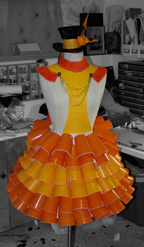 Here is a sneak peek of the cup dress I am making for the Wearable Arts Show in two weeks. The dress is made of plastic drink cups cut in two and stitched on to a under skirt with a hula hoop in th…