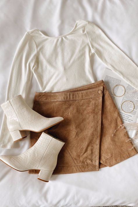 Step into fall in Lulus! Stock-up on faves like the Act Natural Tan Suede Leather Mini Wrap Skirt, Graciously Yours White Long Sleeve Scoop Back Bodysuit, and Bel Ivory Crocodile Print Leather Ankle Booties. These versatile essentials will keep you cute and cozy all season long! #lovelulus