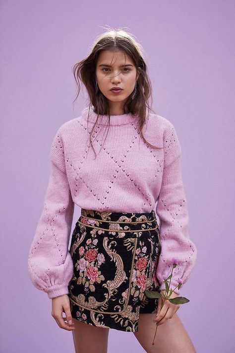 The Mia Pointelle Sweater is the perfect staple for Fall with its candy-colored pastel hue, pointelle diamond design, thick puff neckline, dropped shoulder and oversized fit. Pictured with the Brocade Tapestry Skirt.