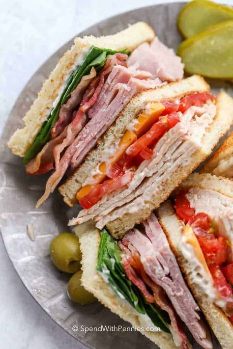 My family loves this club sandwich recipe! With layers upon layers of chicken, turkey, ham, bacon, cheese, lettuce and tomatoes we can't get enough! #spendwithpennies #clubsandwich #chickenclubsandwich #lunch #heartysandwich