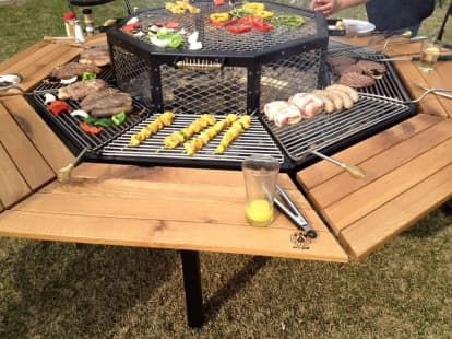 This Tricked Out Fire Pit Is A Grill And Dining Table In One Fire Pit Backyard Fire Pit Essentials Backyard Fire