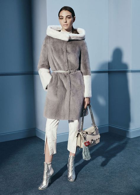 A fur coat with fur around the neck in the sleeves. The rest of the coat and beautiful muted gray suede. Paired with white pants. Isn't it Exquisite look and high heels