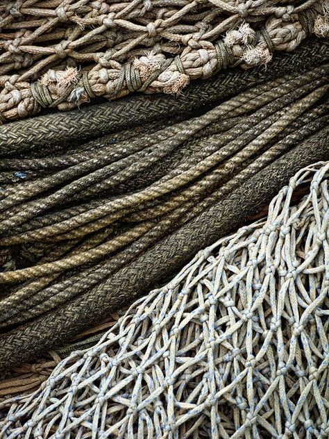 texture: the texture of the ropes and nets reminds me of being on the ocean with these ragged nets that could be used to catch fish or fasten a boat to a dock