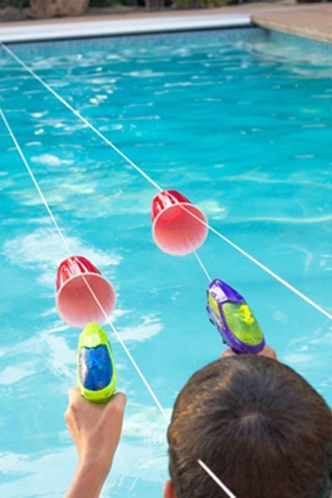 Squirt Gun Races: This elaborate obstacle course will be perfect for your next pool party. Your kids will love using squirt guns to move the cups across the pool. Party 15 Fun Swimming Pool Games For You and Your Family