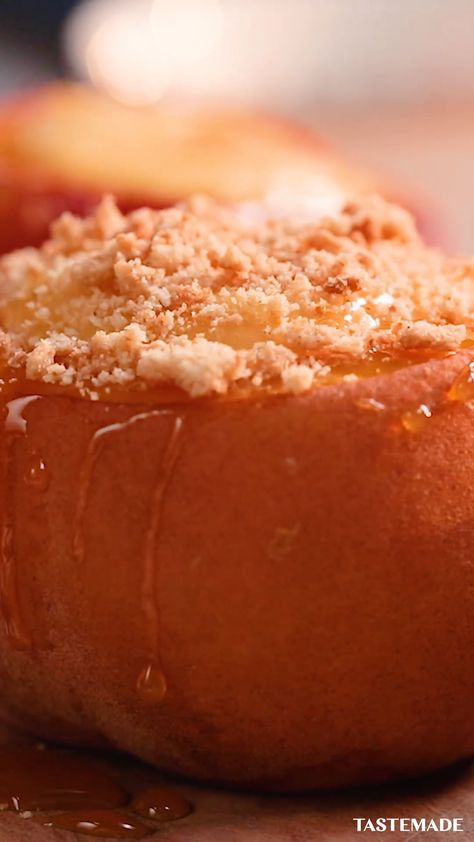 Summer just got a whole lot sweeter with these caramel cheesecake-stuffed baked peaches.