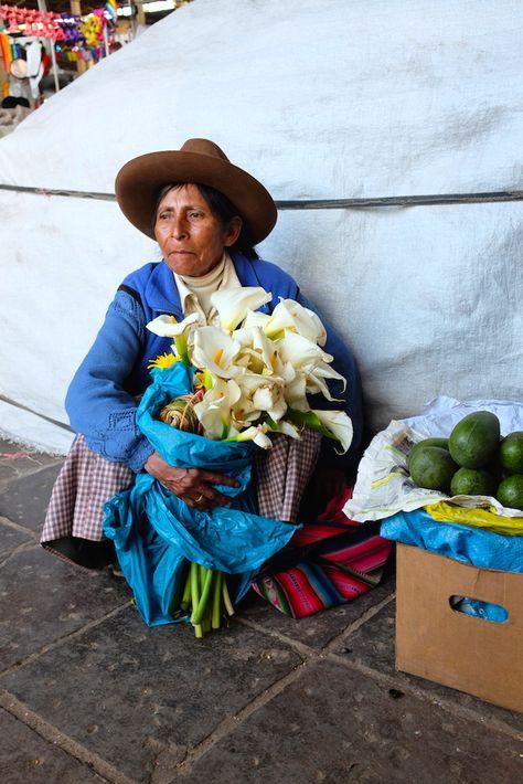 Peruvian Lady selling flowers at Mercado Central de San Pedro- Cusco, Peru