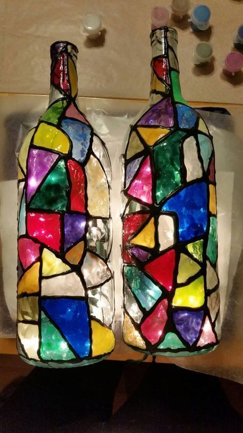 Stained Glass Bottles With Lights Available In 4 Great Designs We Free Hand Draw Out The Lines On Wine Bottle Crafts Bottle Crafts Hand Painted Wine Bottles