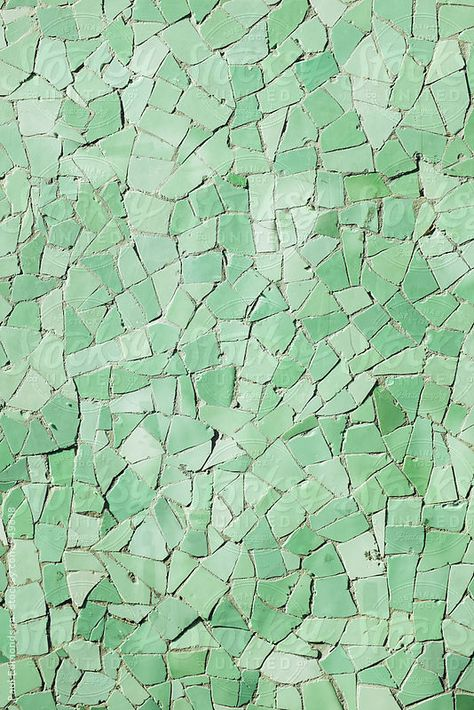 Closeup of green tiles on urban wall by Paul Edmondson for Stocksy United