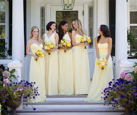 This pale lemon bridal party showcases four different neckline in the same hue.   See more gorgeous floor length bridesmaid dresses here: http://www.mywedding.com/articles/floor-length-bridesmaid-dresses/