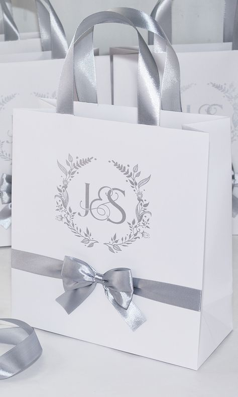 Silver Wedding Monogram Welcome bags with satin ribbon handles, bow and your names. Elegant Personalized Wedding gifts and favors for guests. #weddingbags #weddingwelcomebags #welcomebags #weddingwelcome #giftbags #partyfavor #weddingfavor #weddingfavors #weddingfavour #personalizedgift #weddingwelcome #weddingparty #weddingdecor #elegantwedding #thankyoutag #destinationwedding #welcomeletter  #silverweddingdecor #mrandmrs #elegantparty #silverwedding #weddingmonogram