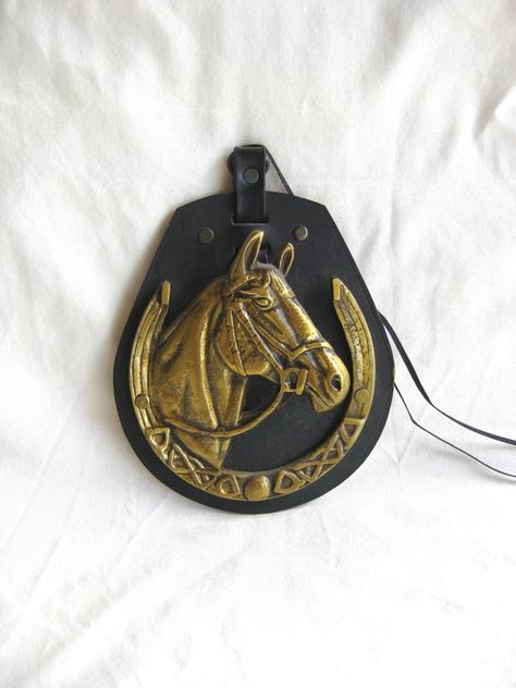 Vintage Brass Horse Head And Horseshoe On Black Leather Wall