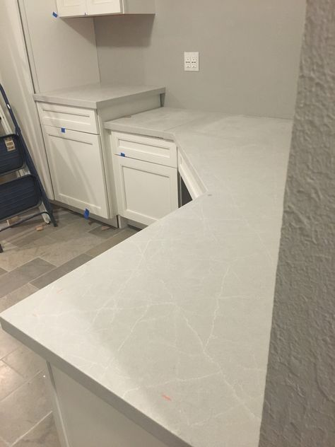 Caesarstone Cosmopolitan White countertops installed in new office and utility. Perfect choice.