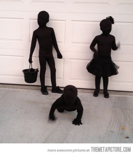 Kids dressed as SHADOWS for Halloween - their mother bought black morph suits for them then layered black clothes over those.  This may be the scariest thing ever! Yup that's creepy