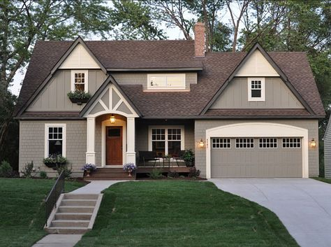 """The body of the house is """"Benjamin Moore Copley Gray"""". Trim of the house is """"Benjamin Moore Elephant Tusk OC-8″."""