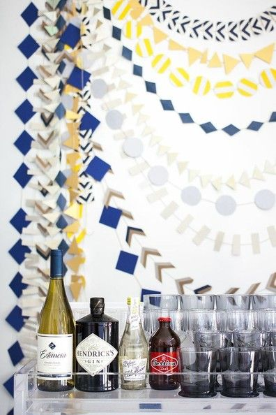 Homemade paper garlands enliven a bar area for a baby shower.