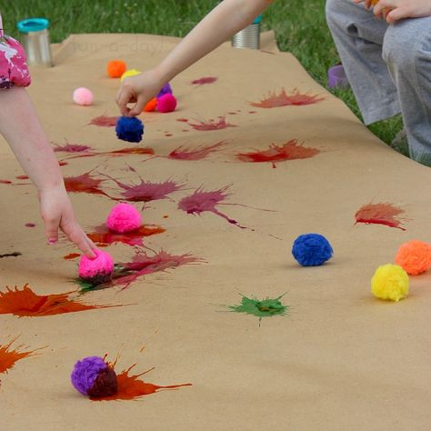 Splat painting with pompoms and liquid watercolors - such fun! Great process art activity for kids.