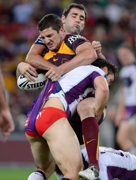 Matt Gillett Photos - Matt Gillett of the Broncos is tackled during the round 24 NRL match between the Brisbane Broncos and the Melbourne Storm at Suncorp Stadium on August 2012 in Brisbane, Australia. - NRL Rd 24 - Broncos v Storm